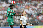 13 August 2008: Dele Adeleye (NGA) (5) heads the ball over Brian McBride (USA) (17).  The men's Olympic team of Nigeria defeated the men's Olympic soccer team of the United States 2-1 at Beijing Workers' Stadium in Beijing, China in a Group B round-robin match in the Men's Olympic Football competition.