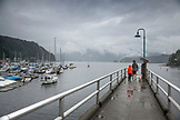 CANADA, Vancouver, British Columbia, father and son walk with their dog on the pier in Deep Cove, North Vancouver