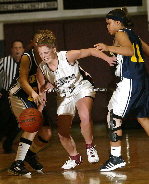 TORRINGTON, CT, 01/04/08- 010408BZ12- Torrington's Lindsey Begay (32) battles through  Kennedy's Amber Alberto (23) and Breana Morrison (11) during their game at Torrington High School Friday night.<br /> Jamison C. Bazinet Republican-American