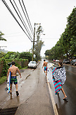 USA, Oahu, Hawaii, MMA Mixed Martial Arts Ultimate fighter Lowen Tynanes, Logan Garcia, Tyson Tynanes and Kyla Tipps head bacck to their house after surfing at Pipeline Beach on the North Shore of Oahu