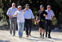 Pictured: Eddie Needham (2nd L), the grandfather of missing Ben Needham with DI Jon Cousins of South Yorkshire Police (L) and other officers in Kos, Greece. Wednesday 05 October 2016<br />