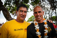 "HONOLULU, Oahu, Waimea Bay - Thursday, November 28, 2012 Former winners Keone Downing (HAW) and Kelly Slater (USA). -- The 28th annual Quiksilver In Memory of Eddie Aikau official opening ceremony and blessing today at Waimea Bay on the North Shore of Oahu. The ceremony  featured this year's 28 Invitees, including newly elected riders John John Florence (Hawaii), Ian Walsh (Maui), and Alex Gray (California), as well as former ""Eddie"" champions Kelly Slater (Florida), Greg Long (California), and Ross Clarke-Jones (Australia). The surfers will be joined by members of the Aikau family, including Eddie's younger brother and Invitee Clyde Aikau...When the Invitees and Alternates paddled out and grouped in the traditional surfer's circle it's about camaraderie and making a connection to the others who will ultimately share in your experience and watch out for your safety..The holding period for the Quiksilver In Memory of Eddie Aikau will commence on Saturday, December 1, and runs through  to February 28, 2013. The event requires one day of quality waves in the giant range of 20 feet or more. Waves of this size are only generated occasionally by hurricane force winds from intense storms in the Pacific NW. The elements of wind, swell height and arrival time to the island's shore must be in perfect alignment to allow a full eight hours of daytime competition..Waimea Bay was Eddie Aikau's home away from home. It was here that he saved countless lives as the Bay's first official lifeguard, and successfully rode the largest waves of his day. An early pioneer of big wave riding in Hawaii, Eddie has inspired generations of ""storm surfers"" who today roam the globe year-round in search of giant waves..The Quiksilver In Memory of Eddie Aikau has only been held a total of eight (8) times, most recently on December 8, 2009. California's Greg Long (California) took the honor that year. .Photo: joliphotos.com"