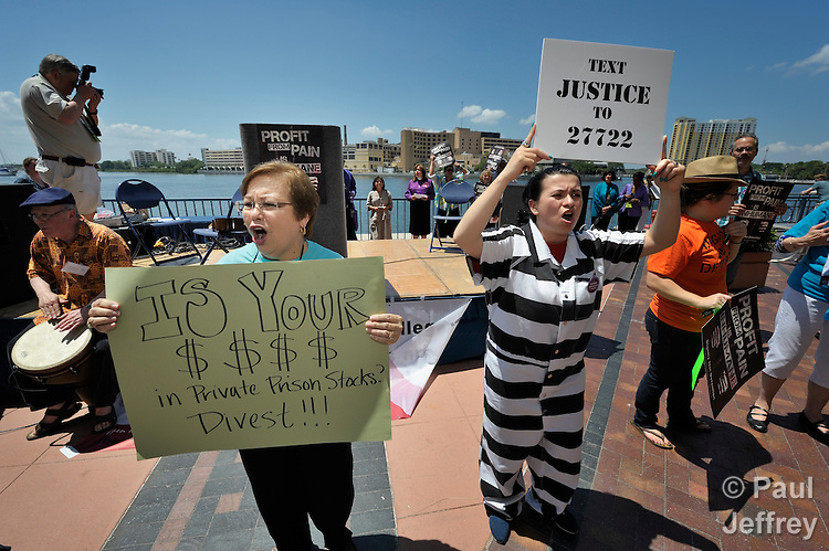 United Methodist Women from around the world participate in an April 28 rally against private prisons held at the 2012 United Methodist General Conference in Tampa, Florida. The rally was sponsored by United Methodist Women and the United Methodist Task Force on Immigration. On the left is Inelda Gonzalez, the president of United Methodist Women.