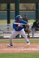 Chicago Cubs right fielder Robert Garcia (24) prepares to lay down a bunt during a Minor League Spring Training game against the Oakland Athletics at Sloan Park on March 13, 2018 in Mesa, Arizona. (Zachary Lucy/Four Seam Images)