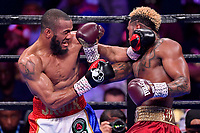 """Fairfax, VA - May 11, 2019: Jarrett """"Swift"""" Hurd lands a right uppercut against Julian J-Rock"""" Williams during Jr. Middleweight title fight against at Eagle Bank Arena in Fairfax, VA. Julian Williams defeated Hurd to take home the IBF, WBA and IBO Championship belts by unanimous decision. (Photo by Phil Peters/Media Images International)"""
