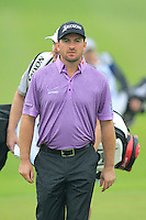 Graeme McDowell (NIR) walks onto the 1st green during Thursday's Round 1 of the 2014 BMW Masters held at Lake Malaren, Shanghai, China 30th October 2014.<br /> Picture: Eoin Clarke www.golffile.ie