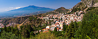 Panoramic photo of Mount Etna Volcano and Taormina seen from Teatro Greco aka Greek Theatre or Amphitheatre, Sicily, Italy, Europe. This is a panoramic photo of Mount Etna Volcano and Taormina seen from Teatro Greco aka Greek Theatre or Amphitheatre, Sicily, Italy, Europe.