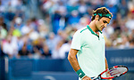 Roger Federer (SUI) battles against Gael Monfils (FRA) at the Western & Southern Open by 76(6) 75 in Mason, OH on August 14, 2014.