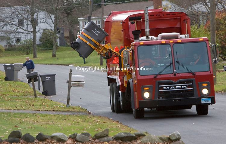 NAUGATUCK, CT. 10 November 2010-111010SV02--Trash crews pick up the trash with the department&rsquo;s new automated trash truck in Naugatuck Wednesday. <br /> Steven Valenti Republican-American