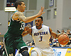 Hempstead, NY - November 30, 2013: Hofstra University No. 3 Zeke Upshaw, right, gets pressured by Manhattan College No. 13 Emmy Andujar during the second half of an NCAA Division 1 men's basketball game at Mack Sports Complex. Upshaw scored a team-high 21 points in an effort that fell short as Manhattan won by a score of 66-59. (Photo by James Escher)