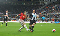 Daniel James of Man Utd hits a shot past Ciaran Clark of Newcastle United during the Premier League match between Newcastle United and Manchester United at St. James's Park, Newcastle, England on 6 October 2019. Photo by J GILL / PRiME Media Images.