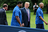 United States President Donald J. Trump, center right, Herschel Walker, center left, Mariano Rivera, right, and Human Services Secretary Alex Azar, walk as they watch young participants during the White House Sports and Fitness Day on the South Lawn on May 30, 2018 in Washington, DC.<br /> CAP/MPI/RS<br /> &copy;RS/MPI/Capital Pictures