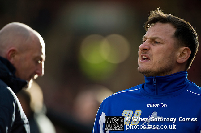 Barnsley 1 Millwall 0, 22/02/2014. Oakwell, Championship. Millwall make the journey from south London to South Yorkshire for a Championship relegation battle with Barnsley. Millwall assistant manager Marc Bircham barks orders on the touchline. Photo by Simon Gill.
