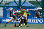Tradition YCAC (in flowered shirts) defeats GFI East Africans (in yellow) 28 to 0 during Day 1 (Pool B) of GFI HKFC Rugby Tens 2016 on 06 April 2016 at Hong Kong Football Club in Hong Kong, China. Photo by Juan Manuel Serrano / Power Sport Images