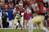 December 7, 2013  (Charlotte, North Carolina)  Florida State Seminoles quarterback Jameis Winston #5 elects to run the ball during the 2013 ACC Championship game against the Duke Blue Devils. FSU defeated Duke 45-7. (Photo by Don Baxter/Media Images International)