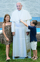 From left, Brenna Veitz, 10 and her brother Declan Veitz, 6 of Morrisville, Pennsylvania interact with a cardboard cutout of Pope Francis during St. John the Evangelist's 50th Anniversary picnic celebration Sunday June 14, 2015 in Lower Makefield, Pennsylvania.  (Photo by William Thomas Cain/Cain Images)
