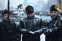 Orthodox priests  under the snow support  the  protest against new draconian law to ban protests across the country.  Kiev. Ukraine