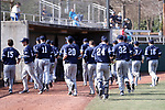 CARY, NC - FEBRUARY 23: Monmouth players head to the dugout before the game. The Monmouth University Hawks played the Saint John's University Red Storm on February 23, 2018 on Field 2 at the USA Baseball National Training Complex in Cary, NC in a Division I College Baseball game. St John's won the game 3-0.