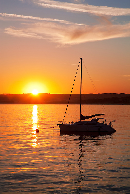 Sunrise and sailboat. Monterey Bay, Caliifornia