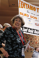 Joanne Potts, Assitant to the Race Director of Iditarod, helps during the mandatory musher meeting at the Millenium hotel two days prior to the start of Iditarod 2013...Photo (C) Jeff Schultz/IditarodPhotos.com  Do not reproduce without permission.
