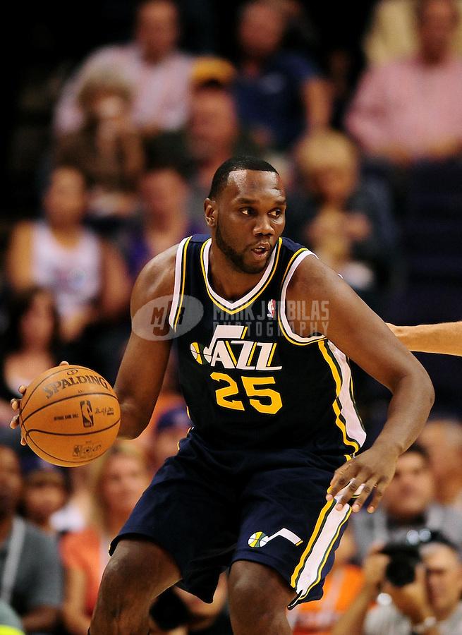 Oct. 12, 2010; Phoenix, AZ, USA; Utah Jazz center (25) Al Jefferson against the Phoenix Suns during a preseason game at the US Airways Center. Mandatory Credit: Mark J. Rebilas-