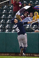 Jamie Romak (26) of the Northwest Arkansas Naturals makes a catch in foul territory during a game against the Springfield Cardinals on May 13, 2011 at Hammons Field in Springfield, Missouri.  Photo By David Welker/Four Seam Images.