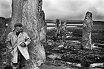Callanish Standing Stones, Callanish Isle of Lewis and Harris,  Sheep farmer sheltering from the wind and rain.