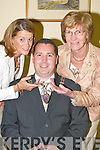 CELEBRATING: New Killarney mayor, Niall OCallaghan, celebrates with his family as his kids check.out the chain of office at Killarney Council Chambers last Tuesday night. Front row l-r: Megan, Dermot,.Amy, Niall (Mayor of Killarney), Darragh and Kathy OCallaghan. Back row l-r: Valerie, Dermot,.Paudie and Eileen OCallaghan.