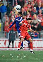 26 April 2009: Kansas City midfielder Roger Espinoza #17 and Toronto FC forward Pablo Vitti #8 jump for a ball during an MLS game at BMO Field between Kansas City Wizards and Toronto FC..Toronto FC won 1-0. .