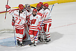 MADISON, WI - SEPTEMBER 29: The Wisconsin Badgers women's hockey celebrates their victory against the Quinnipiac Bobcats at the Kohl Center on September 29, 2006 in Madison, Wisconsin. The Badgers beat the Bobcats 3-0. (Photo by David Stluka)