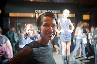 Cynthia Rowley outside the Cynthia Rowley boutique on Bleecker Street in the West Village in New York on Friday, September 10, 2010 during the second annual Fashion's Night Out event. On the first evening of New York Fashion Week stores around the city offered sales and bargains as well as parties and events to entice customers to shop. The event has been so successful in boosting sales that this year over 100 cities in the US are having their own events, and Fashion's Night Out is being planned for 16 countries. (© Richard B. Levine)