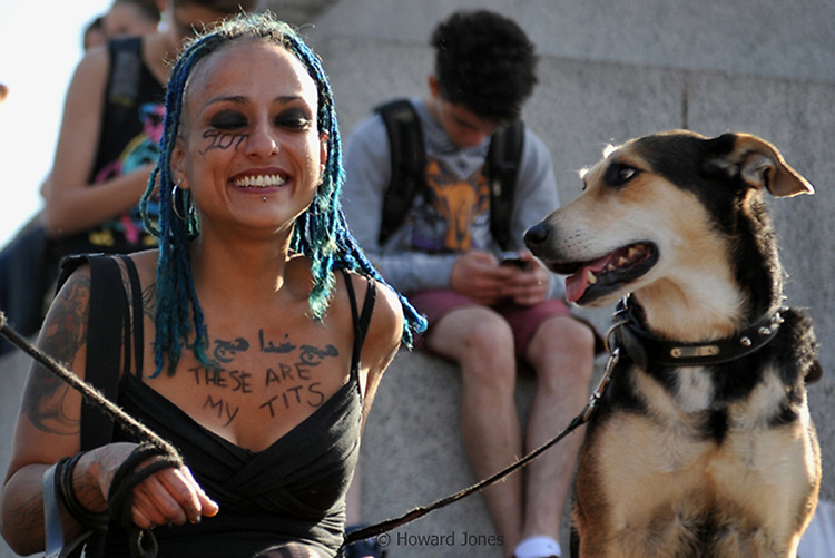 Around 1500 people took part in the second SlutWalk march and demonstration against rape..SlutWalk orginated in Canada when a policeman commentated that women should avoid dressing like sluts to remain safe. Pictured here are two demonstrators relaxing at the end of the march in Trafalgar Square. London, 22nd September 2012
