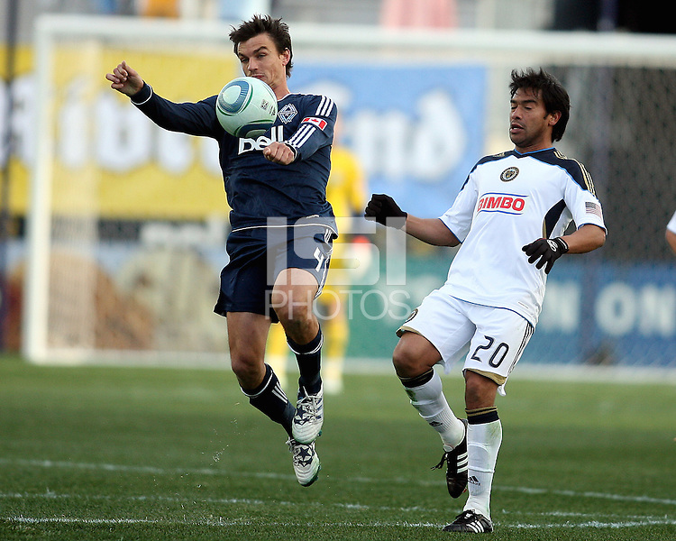 Carlos Ruiz#20 of the Philadelphia Union loses the ball to Alain Rochat#4 of the Vancouver Whitecaps during an MLS match at PPL Park in Chester, PA. on March 26 2011. Union won 1-0.