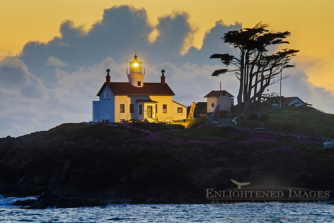 Storm clouds at sunset behind Battery Point Lighthouse, Crescent City, Del Norte County, California