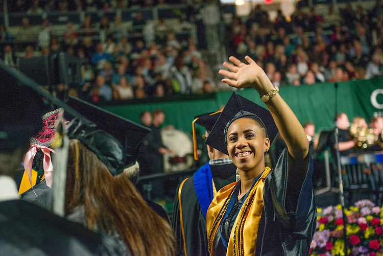 Jasmine Craig waves to supporters dat undergraduate commencement. Photo by Ben Siegel