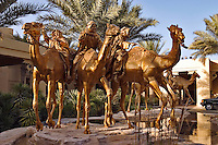 Dubai, United Arab Emirates. Royal Mirage Hotel.  Camel Courtyard.  Camel sculptures by Danie de Jager..