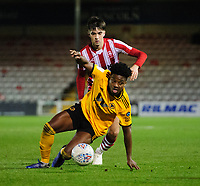 Wolverhampton Wanderers U21's Niall Ennis shields the ball from Lincoln City's Ellis Chapman<br /> <br /> Photographer Chris Vaughan/CameraSport<br /> <br /> The EFL Checkatrade Trophy Northern Group H - Lincoln City v Wolverhampton Wanderers U21 - Tuesday 6th November 2018 - Sincil Bank - Lincoln<br />  <br /> World Copyright © 2018 CameraSport. All rights reserved. 43 Linden Ave. Countesthorpe. Leicester. England. LE8 5PG - Tel: +44 (0) 116 277 4147 - admin@camerasport.com - www.camerasport.com