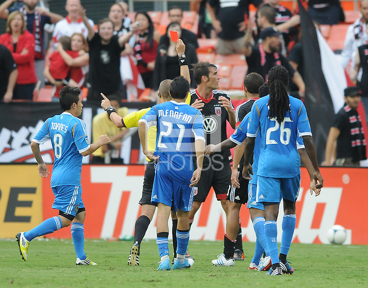 D.C. United defender Emiliano Dudar (19) gets a red card from referee Mark Geiger during the second half of the game. D.C. United tied The Philadelphia Union 1-1 at RFK Stadium, Saturday August 19, 2012.