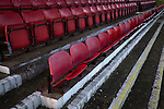 Seats in the stand at Lye Meadow before Alvechurch hosted Highgate United in a Midland Football League premier division match. Originally founded in 1929 and reformed in 1996 after going bust, the club has plans to move from their current historic ground to a new purpose-built stadium in time for the 2017-18 season. Alvechurch won this particular match by 3-0, watched by 178 spectators, taking them back to the top of the league.