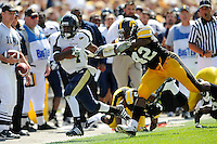 6 September 2008:  FIU wide receiver TY Hilton (4) attempts to evade Iowa linebacker Jeremiha Hunter (42) in the second half of the Iowa 42-0 victory over FIU at Kinnick Field in Iowa City, Iowa.