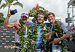 KONA, HAWAII - OCTOBER 14:  Patrick Lange of Germany celebrates his overall victory and New Course Record of 8:01.40 with 2nd place Lionel Sanders (left) and 3rd Place David McNamee of Great Britain during the 2017 IRONMAN World Championships on October 12, 2017 in Kona, Hawaii. (Photo by Donald Miralle for IRONMAN)