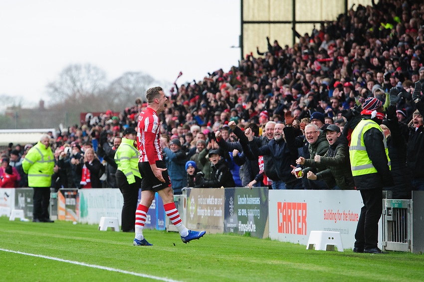 Lincoln City's Harry Toffolo celebrates scoring the opening goal<br /> <br /> Photographer Chris Vaughan/CameraSport<br /> <br /> The EFL Sky Bet League Two - Lincoln City v Grimsby Town - Saturday 19 January 2019 - Sincil Bank - Lincoln<br /> <br /> World Copyright © 2019 CameraSport. All rights reserved. 43 Linden Ave. Countesthorpe. Leicester. England. LE8 5PG - Tel: +44 (0) 116 277 4147 - admin@camerasport.com - www.camerasport.com