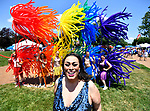 Dieta Pepsi poses in front of the St. Louis Balloon Brigade at the fourth annual Pride St. Charles Festival held at Frontier Park in St. Charles, Missouri on Saturday July 16, 2018. Dieta, also known as Leon Braxton, Jr., was mistress of ceremonies at the event and is a well-known female impersonator who uses a pronoun as a non-binary reference to herself. Non-binary is a catch-all category for gender identities that are not exclusively masculine or feminine.
