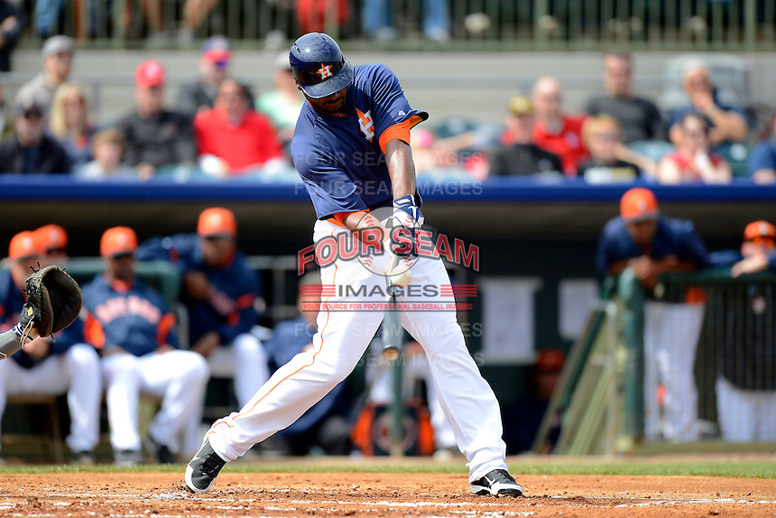 Houston Astros outfielder Chris Carter #13 breaks his bat during a Spring Training game against the St. Louis Cardinals at Osceola County Stadium on March 1, 2013 in Kissimmee, Florida.  The game ended in a tie at 8-8.  (Mike Janes/Four Seam Images)