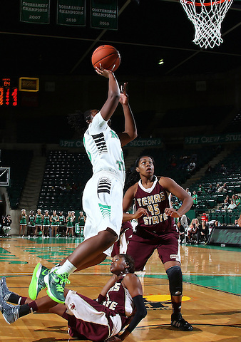 Denton, TX - NOVEMBER 12: BreAnna Dawkins #22 of the University of North Texas Mean Green drives in for two points as Alexis Hyder #33 looks on against Texas State Bobcats at the Super Pit in Denton on November 12, 2012 in Denton, Texas. (Photo by Rick Yeatts)