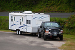 Black Ford Super Duty towing travel trailer