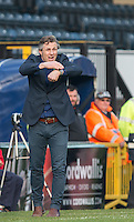 Wycombe Wanderers Manager Gareth Ainsworth points to his watch for full time during the Sky Bet League 2 match between Wycombe Wanderers and Stevenage at Adams Park, High Wycombe, England on 12 March 2016. Photo by Andy Rowland/PRiME Media Images.