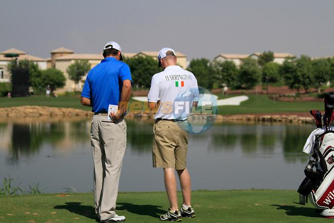Padraig Harrington and caddy Ronan Flood on the par3 6th tee during Day 1 of the Dubai World Championship, Earth Course, Jumeirah Golf Estates, Dubai, 25th November 2010..(Picture Eoin Clarke/www.golffile.ie)