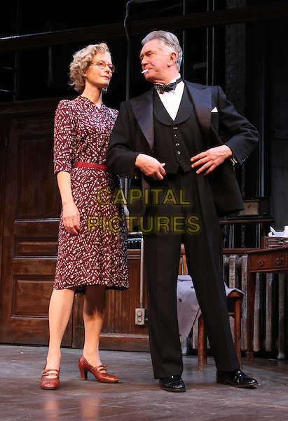 JENNY SEAGROVE & MARTIN SHAW .Photocall for 'The Country Girl' at the Apollo Theatre, Shaftesbury Avenue, London, England, UK, October 8th 2010.play on stage costume full length belt red maroon print dress tuxedo bow tie tux  black suit cigarette smoking .CAP/ROS.©Steve Ross/Capital Pictures