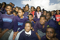 Eritrea. Maekel province. Asmara. Adulis junior school. School based tuberculosis activity. Behavioural Change Communication (BCC). Peers education on tuberculosis promotion. Black students wearing blue uniforms are listening to a play on tuberculosis. The Global Fund through the eritrean Ministry of Health supports the programm with a Tuberculosis grant (financial aid). © 2006 Didier Ruef